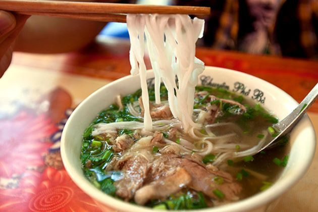 enjoy pho on Vietnam honeymoon