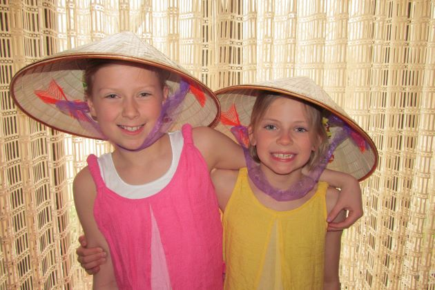 kids with conical hats luxury tour company in southeast asia