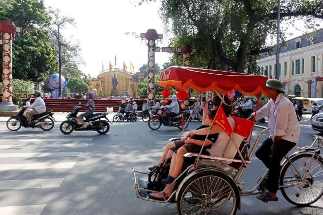 take a cyclo trip to visit hanoi old quarter