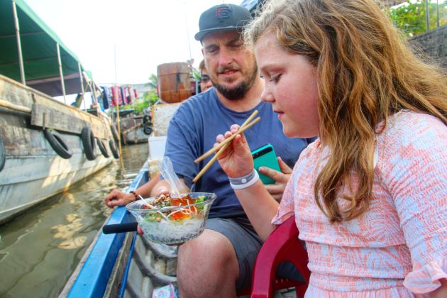 taste local specialty in family trip to mekong delta